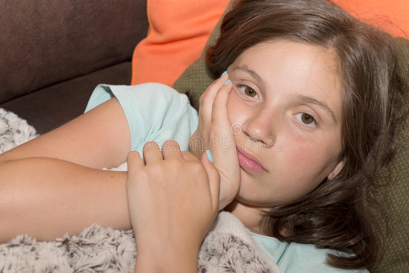 Young cute child girl have a toothache royalty free stock images