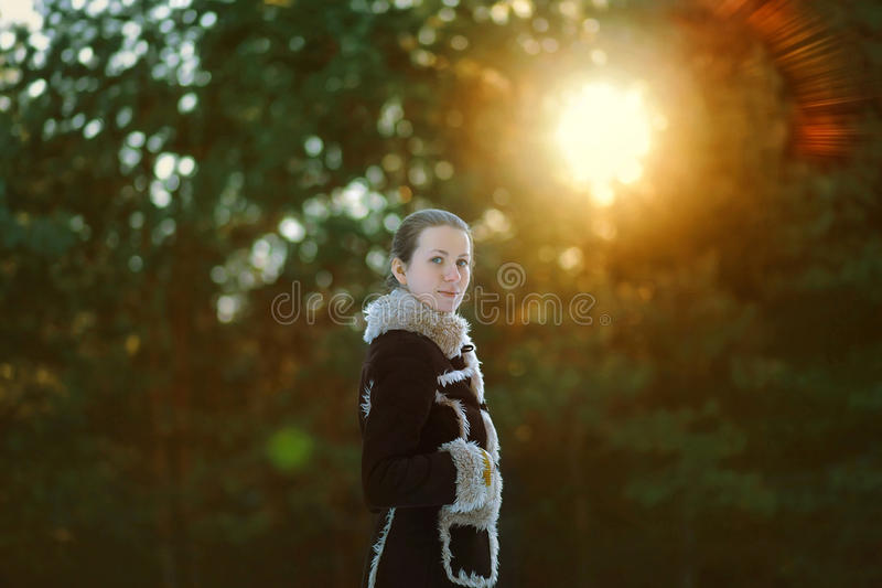 Young cute girl posing in the forest royalty free stock images
