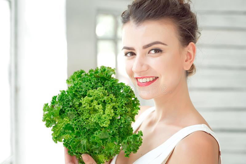 Young cute girl with salad. royalty free stock images