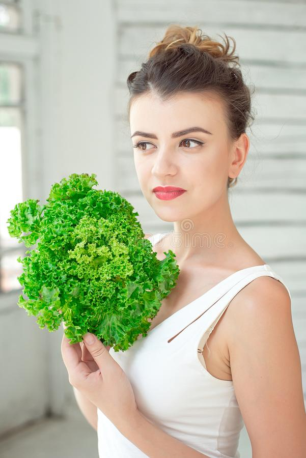 Young cute girl with salad. royalty free stock photo