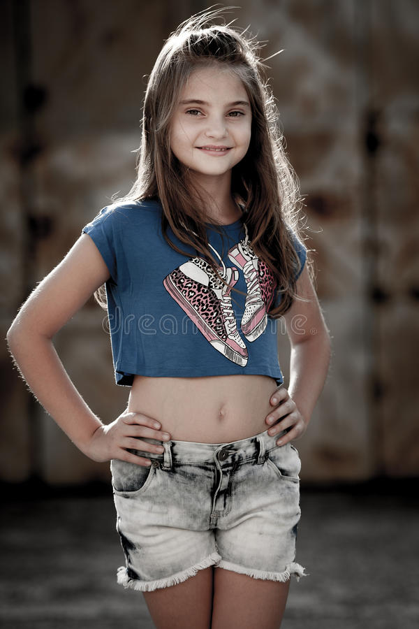 Young cute girl on a street royalty free stock photo