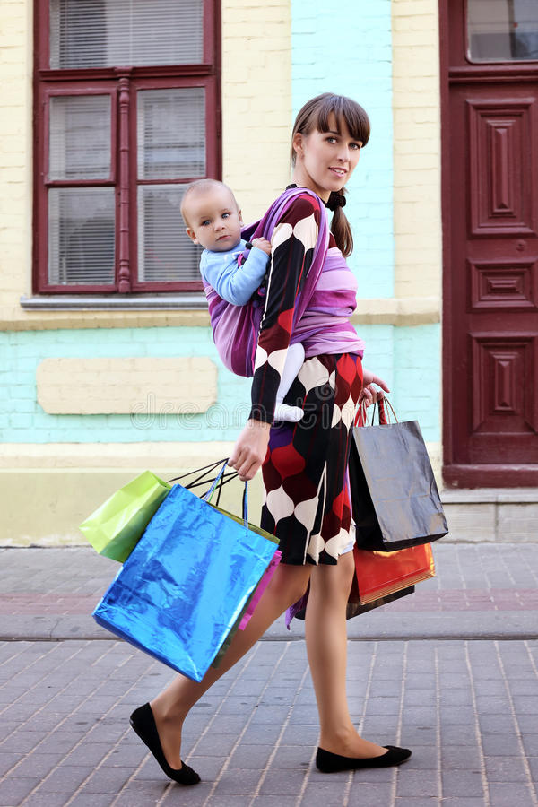 Download Young Cute Mother With Baby In Sling Stock Photo - Image: 29695726