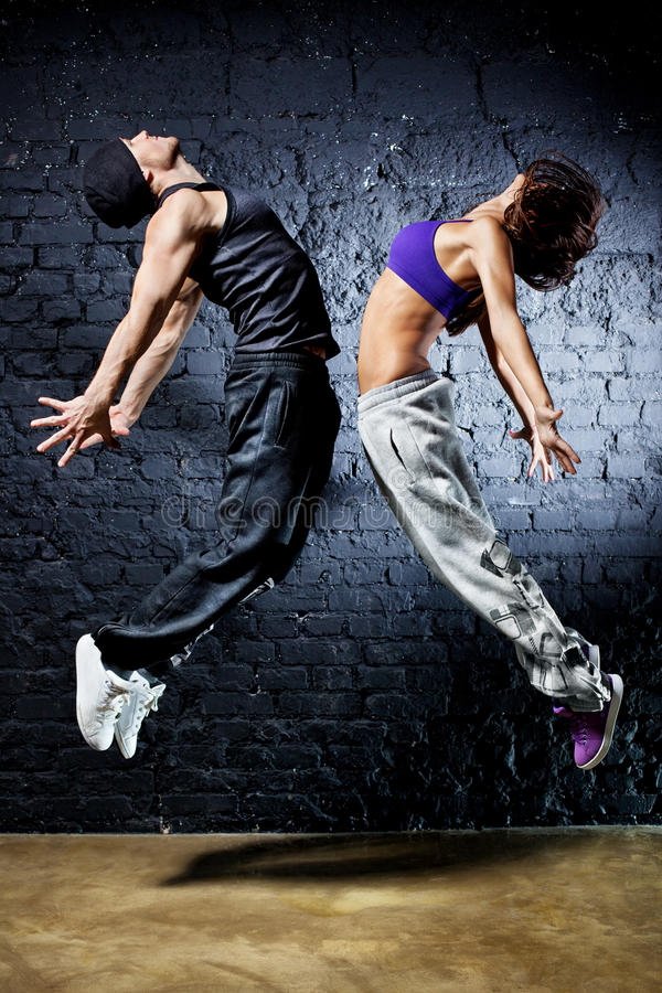 Young dancer couple jumping stock photos