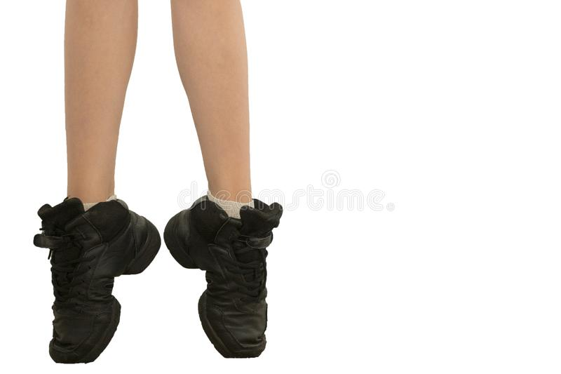 Young dancer... low angle shot of just feet and legs. Young dancer... low angle shot of just feet and legs - this view has had the color removed from the floor royalty free stock photography