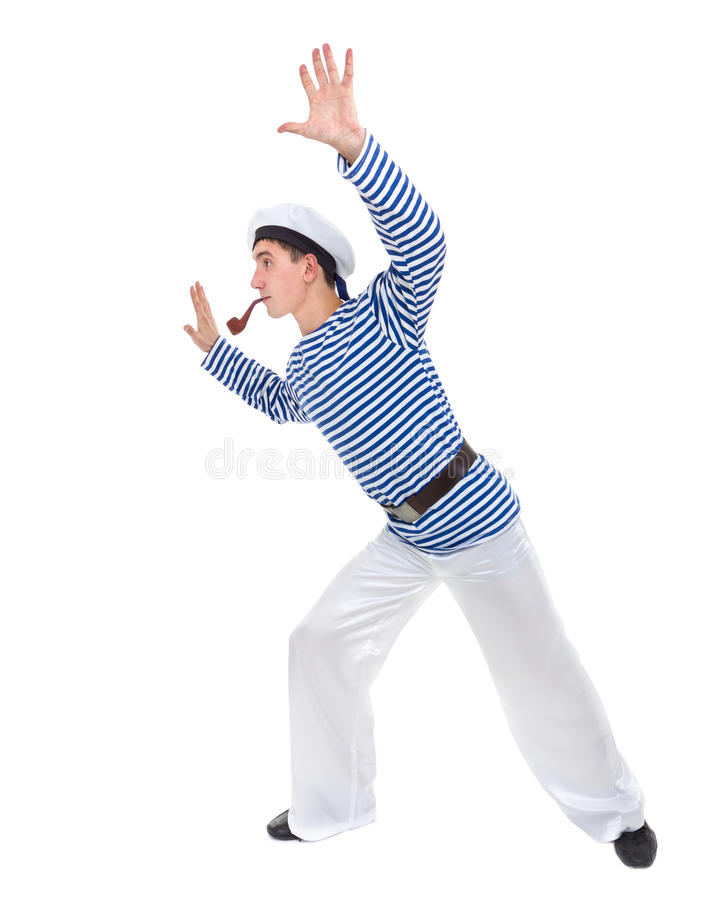 Young dancer man dressed as a sailor posing against isolated white in full length. royalty free stock photo