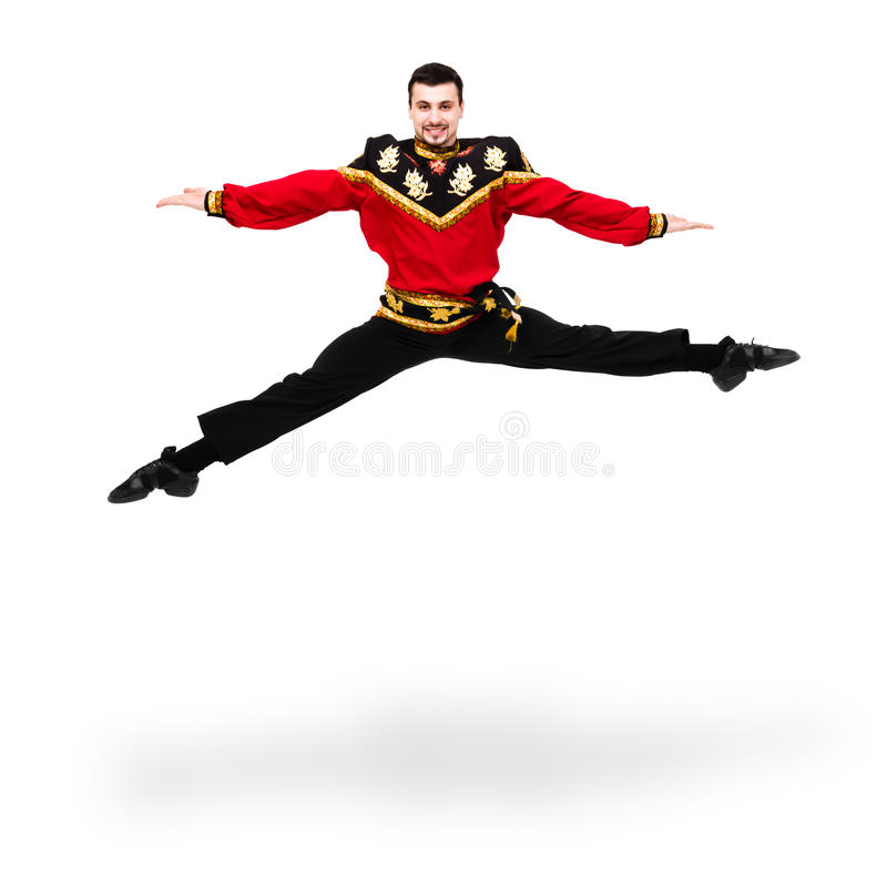 Young dancer man wearing a folk russian costume jumping. Against isolated white background royalty free stock photography