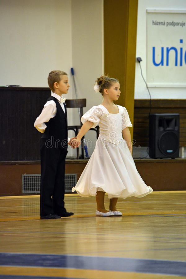 Young dancers. In formal costumes on competition in the school gym in Tisnov city, Czech republic. Photo taken on March, 2015 royalty free stock image