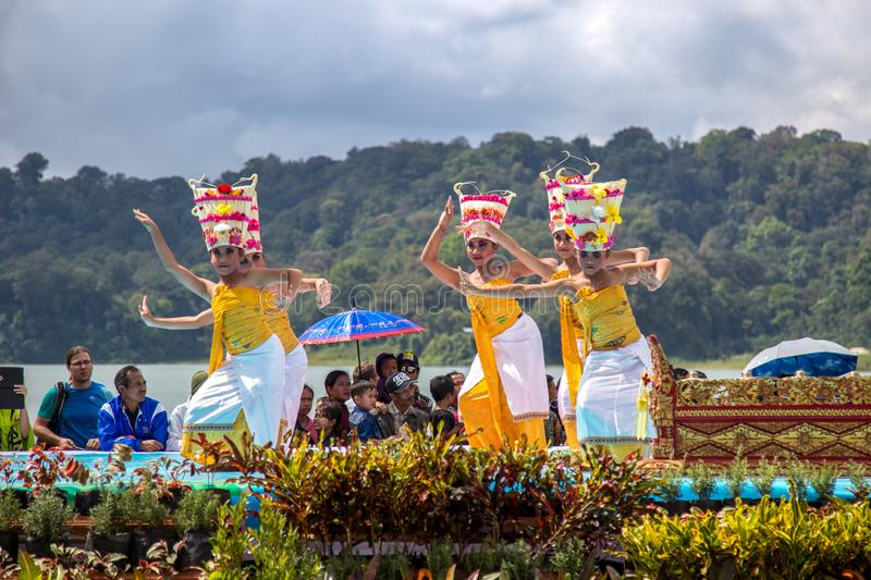 Young dancers in traditional costumes perform a welcome dance in Twin Lake Festival in Bali, Indonesia. June 2018 royalty free stock photo