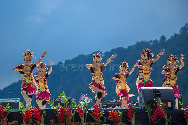 Young dancers in traditional costumes perform a welcome dance in Twin Lake Festival in Bali, Indonesia. June 2018 stock photos