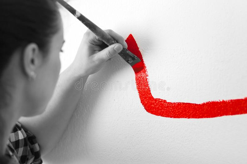 Woman paint little car royalty free stock image