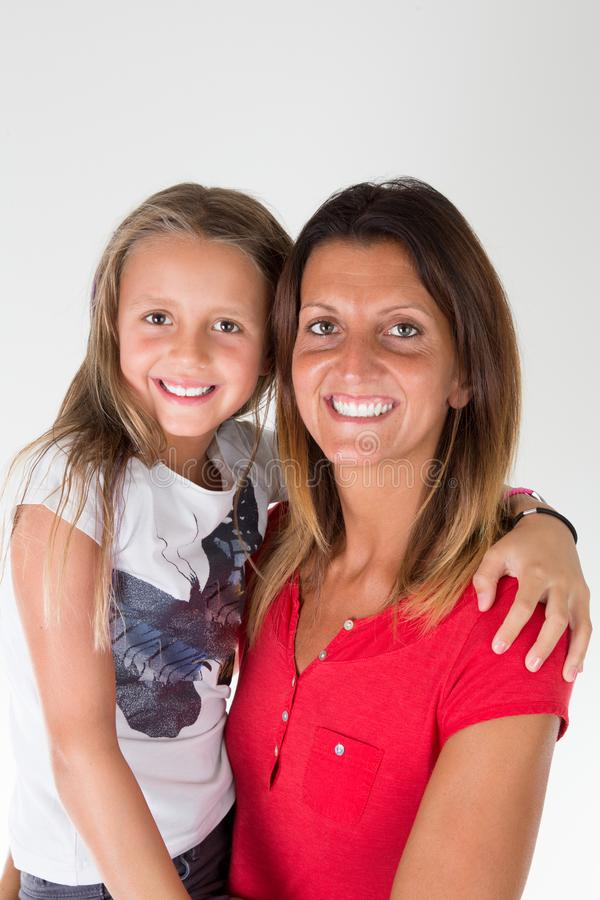 Young daughter child with her cute mother on white background stock images