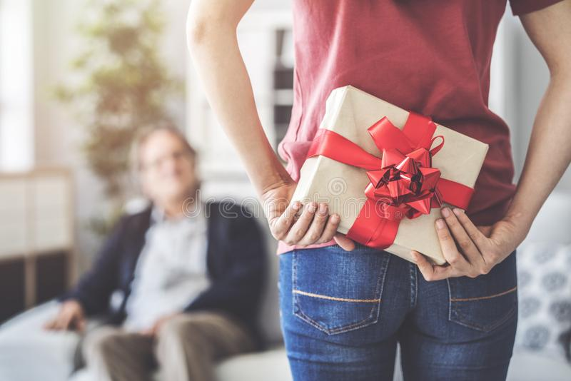 Young daughter gives her father a gift royalty free stock photography