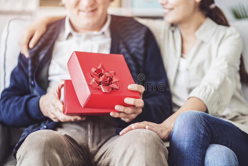 Young daughter gives her father a gift royalty free stock photo