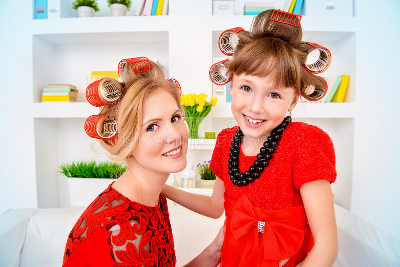 Young daughter and mom stock photo