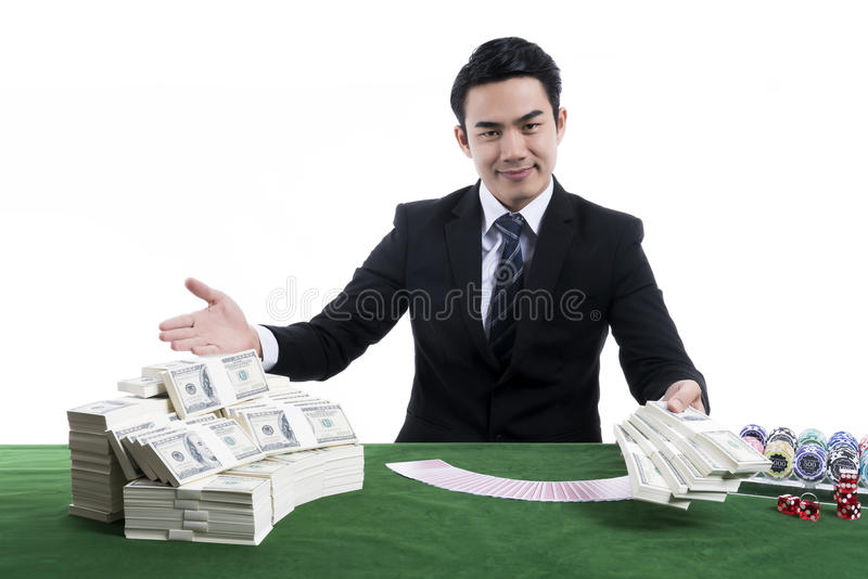 The young dealer holding banknote with gesture inviting and gambling devices on green table royalty free stock photos