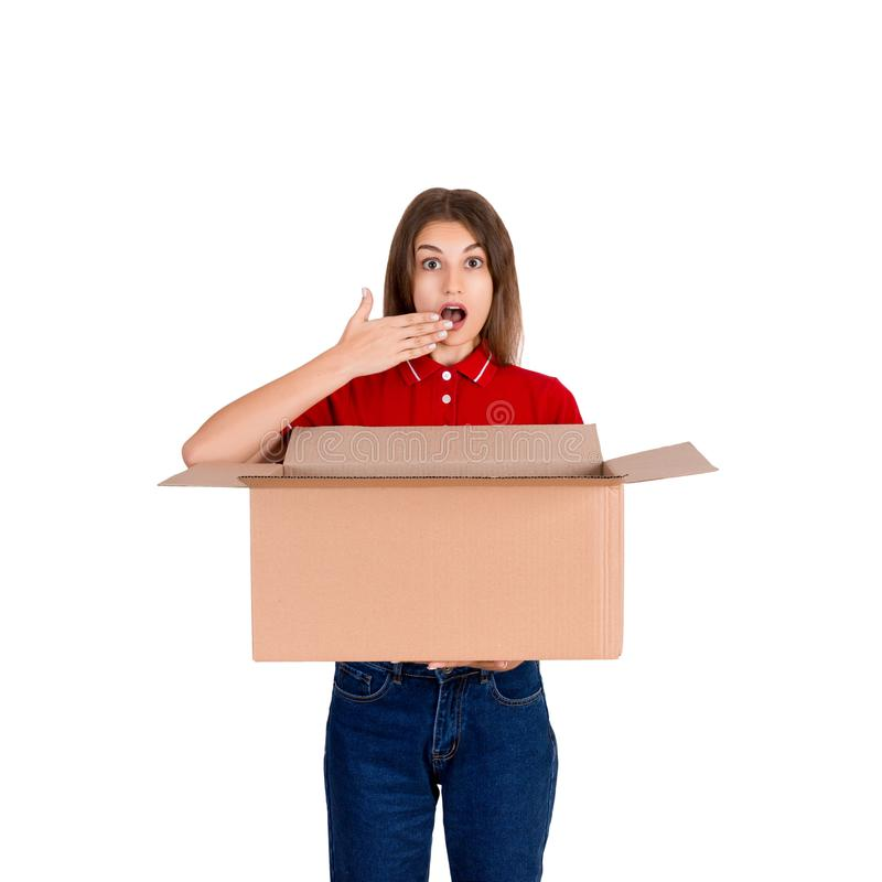 Young delivery woman is making a surprise gesture isolated on white background royalty free stock photos