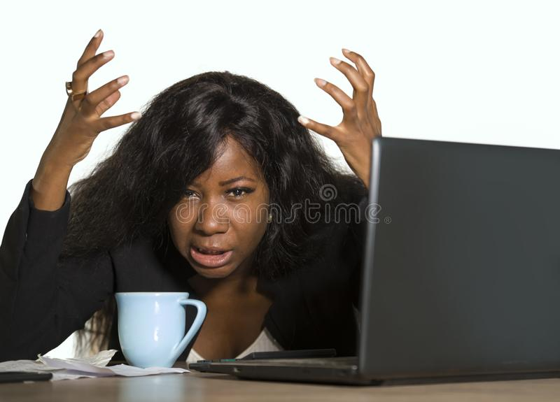 Young depressed and overwhelmed black African American business woman working frustrated at office computer desk feeling upset and. Overworked suffering stress stock image
