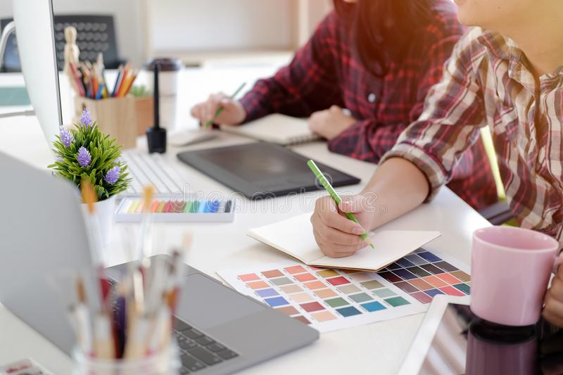 Graphic designer using digital tablet and computer royalty free stock photos