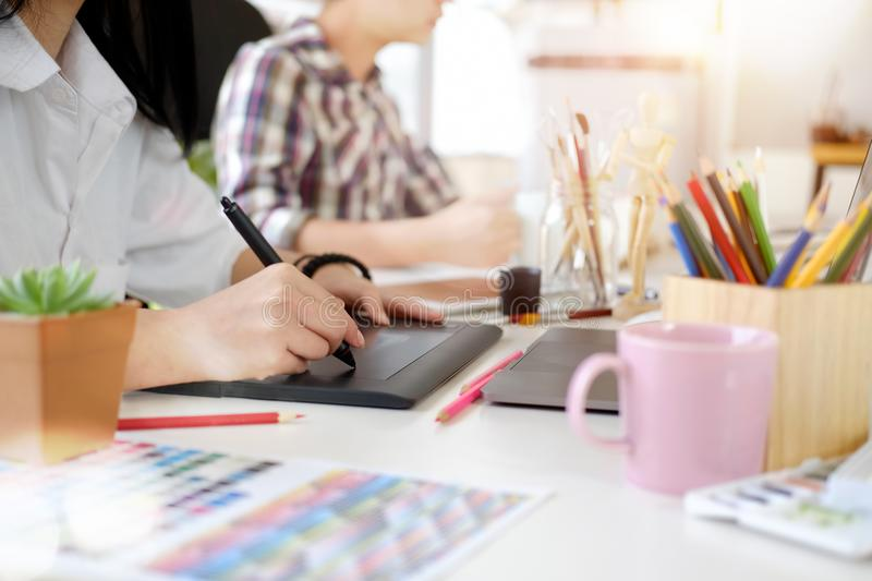 Graphic designer using digital tablet and computer stock photos