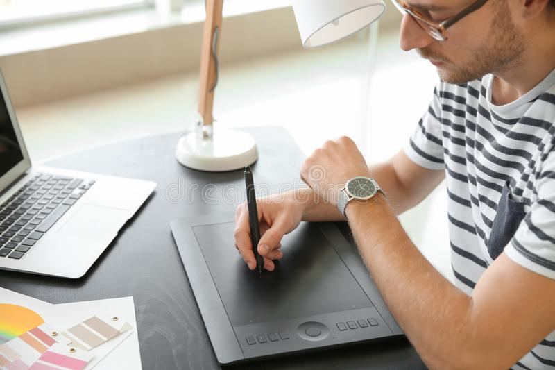 Young designer with graphic tablet working in office royalty free stock photos