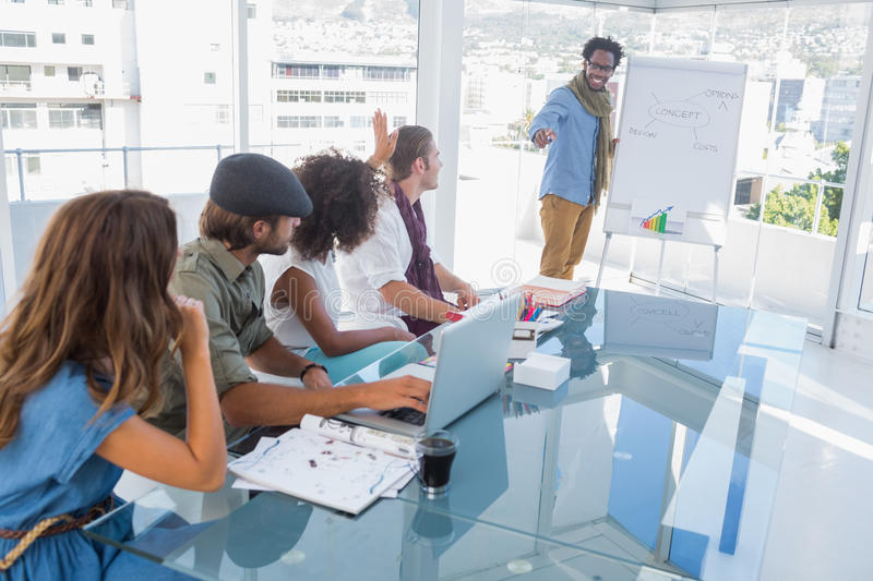 Young designer presenting a flow chart during a meeting stock images