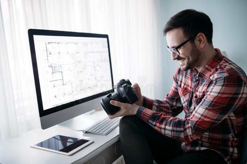 Young designer working on project at home stock photo