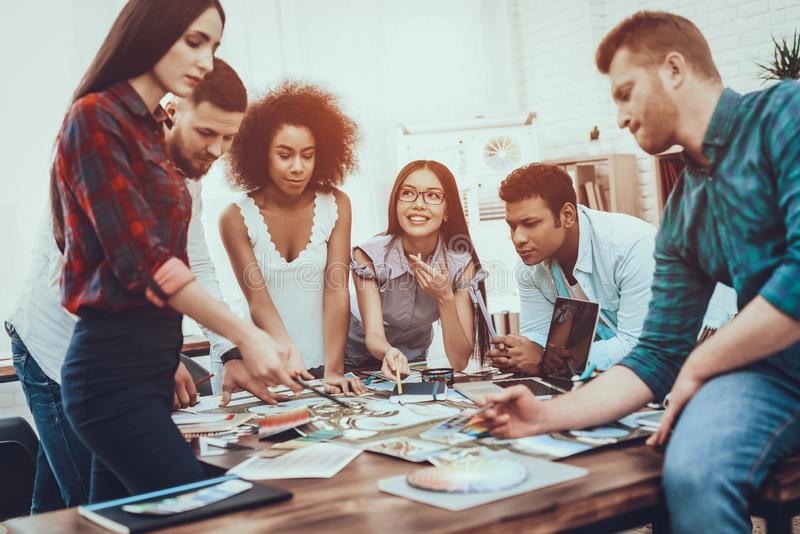 Young. Designers. Different Nationalities. Table. stock image