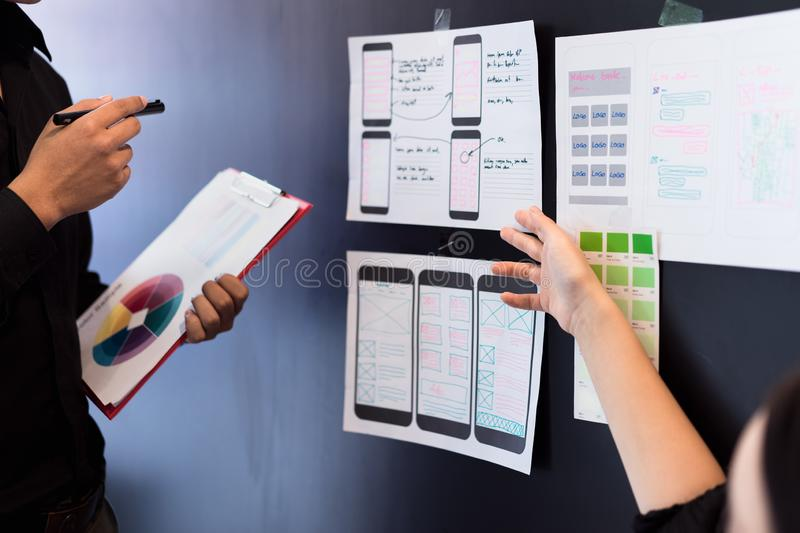 Young designers teamwork working with color samples mobile responsive website development with UI/UX, Brainstorming Planning. App, interface, flat, navigation royalty free stock photos