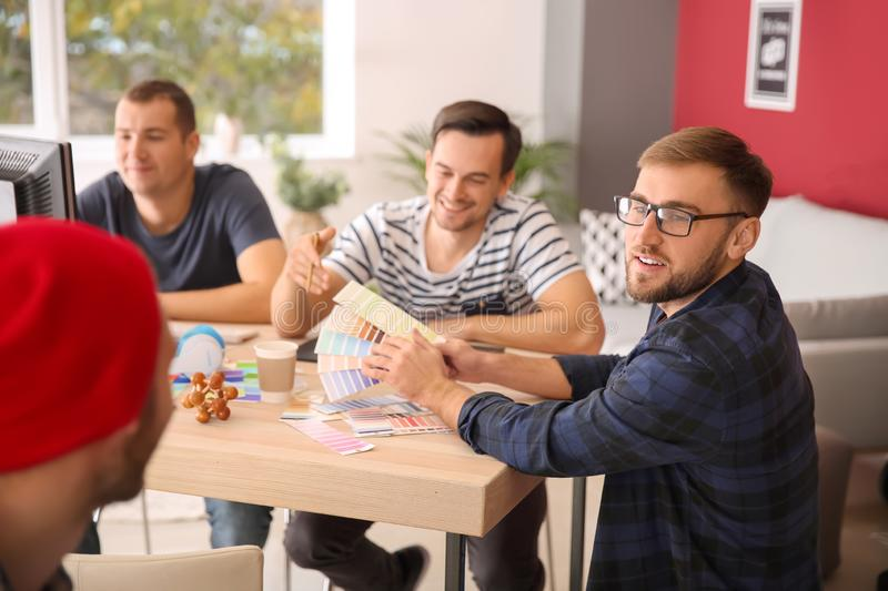 Young designers working in office royalty free stock image