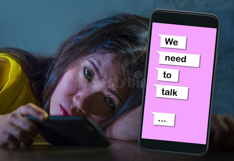 Young desperate and sad Asian Korean woman feeling depressed suffering pain and broken heart composite with mobile phone online. Text in relationship problem stock photos