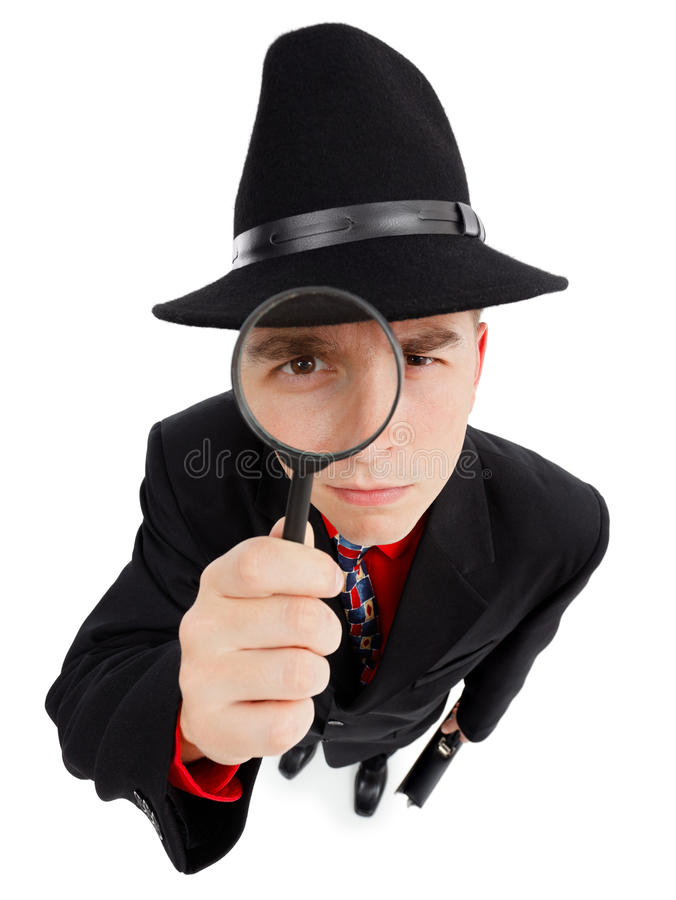 Young detective with magnifier. Wide angle top view of a young detective, looking up through magnifier