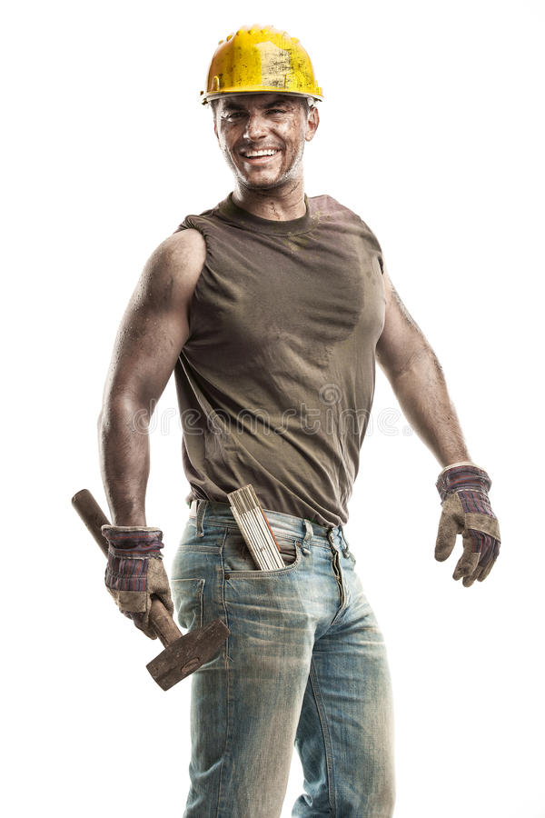 Young dirty Worker Man With Hard Hat helmet holding a hammer a stock photography