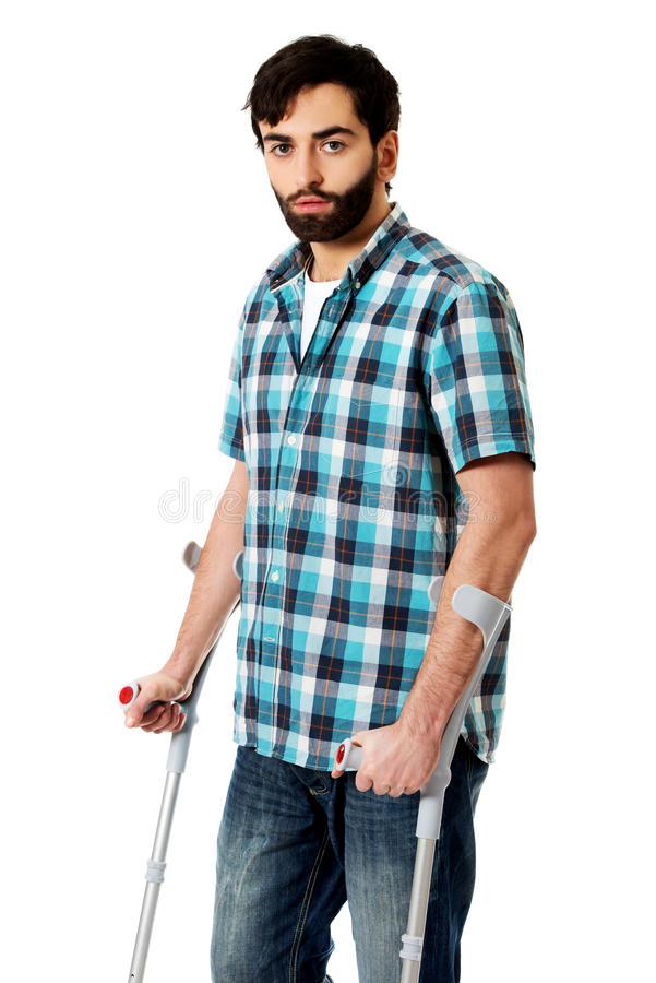 Young disabled man with crutches. royalty free stock photos