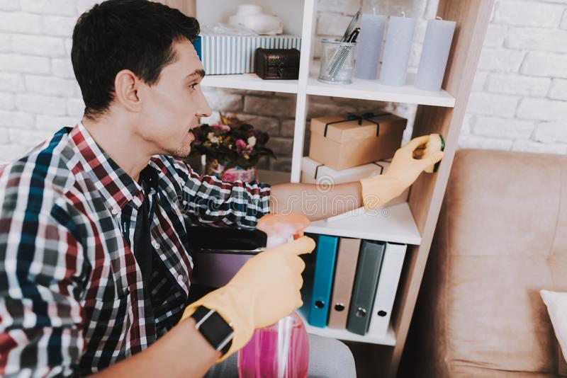 Young Disabled Man on Wheelchair Cleaning at Home. royalty free stock images