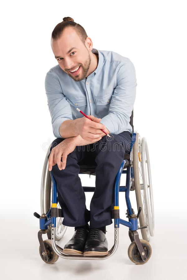 Disabled man holding pen stock images