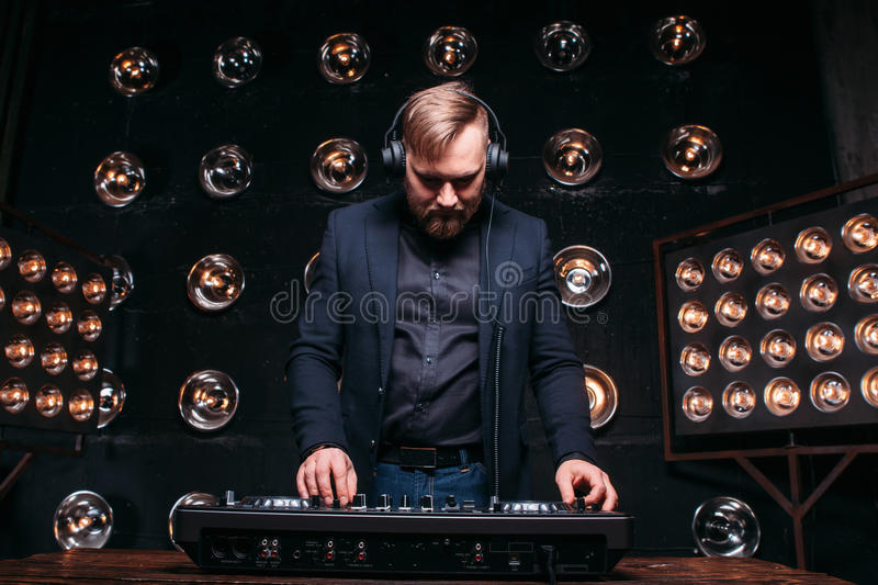 Young disk jockey check console equipment at club stock photography