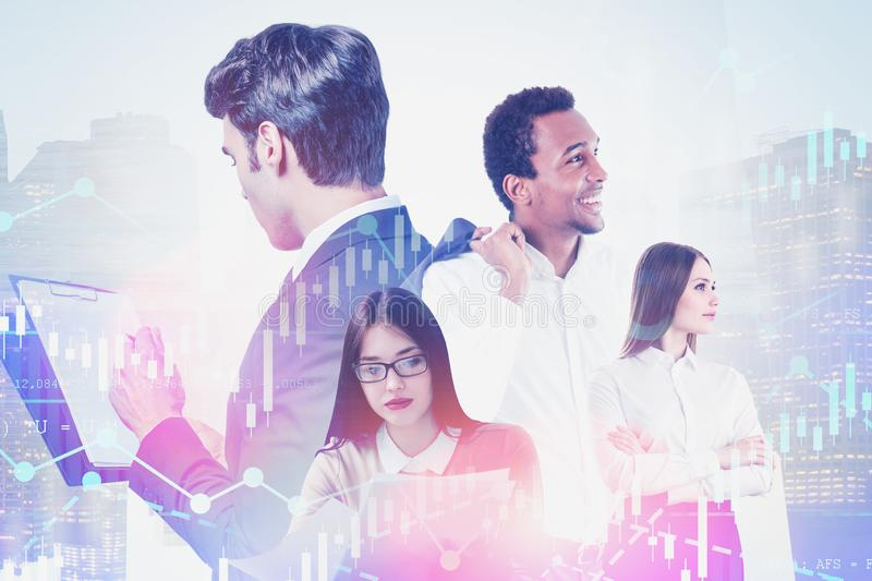 Young diverse business team in city, diagrams stock photo