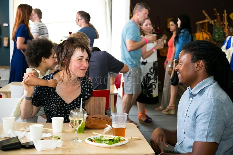 A young diverse family enjoying a day out at a Food and Wine Fair drinking and generally enjoying a day out at a Food and Wine. Johannesburg, South Africa stock images