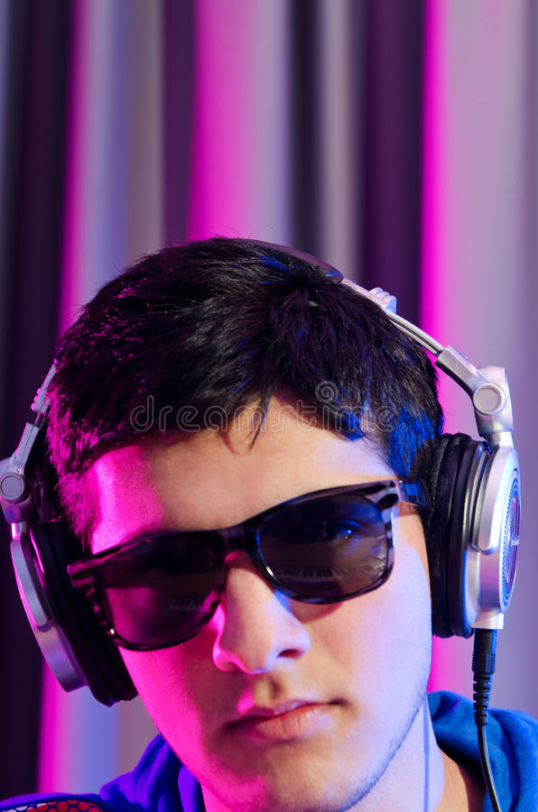 Download Young DJ playing music stock photo. Image of background - 24168162