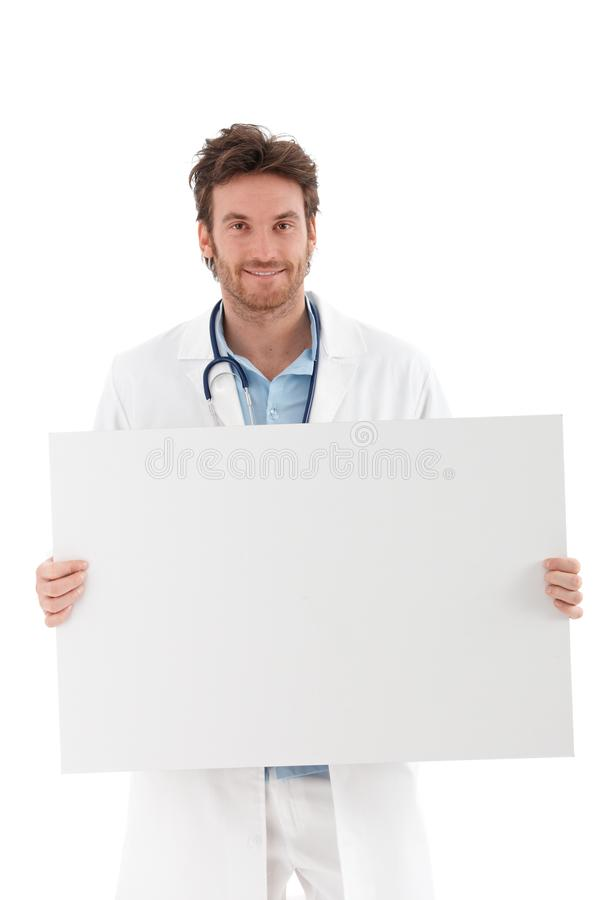 Download Young Doctor With Blank Sheet Smiling Royalty Free Stock Images - Image: 22199259