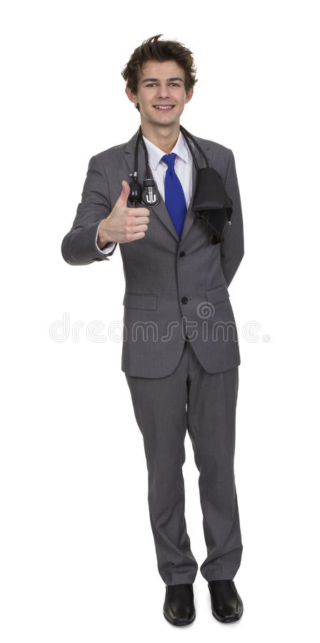 Young Doctor With Blood Pressure Cuff Showing Thumb Up Sign stock photos