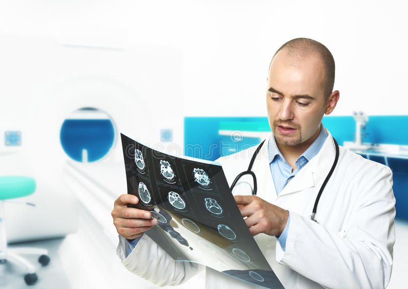 Young doctor check tomography stock images