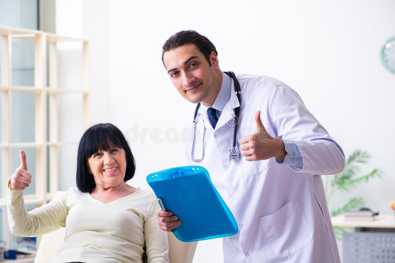 Young doctor examining senior old woman stock images