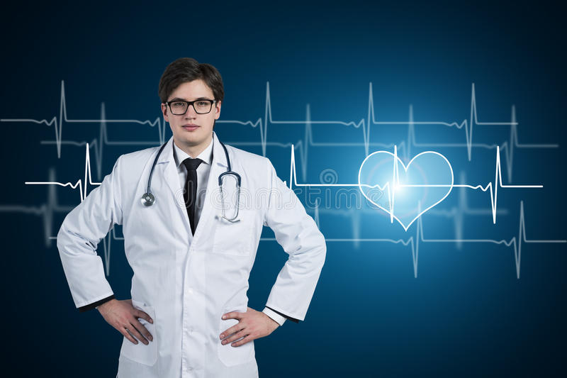 Young doctor, heart and cardiogram royalty free stock image