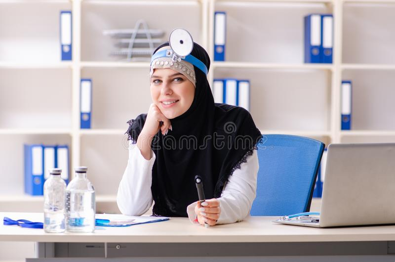 Young doctor in hijab working in the clinic stock image