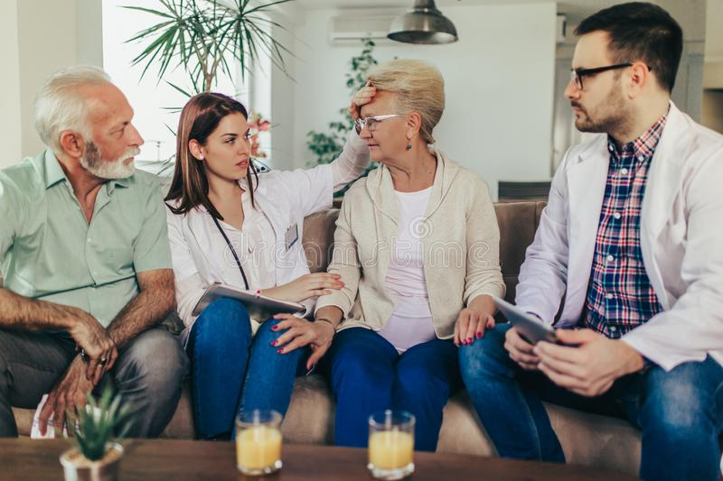 Young doctor during home visit senior people stock image