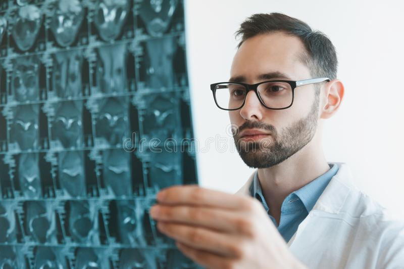 Young doctor looking at Magnetic resonance imaging shot of knee-joint. meniscus injury. Closeup stock photos
