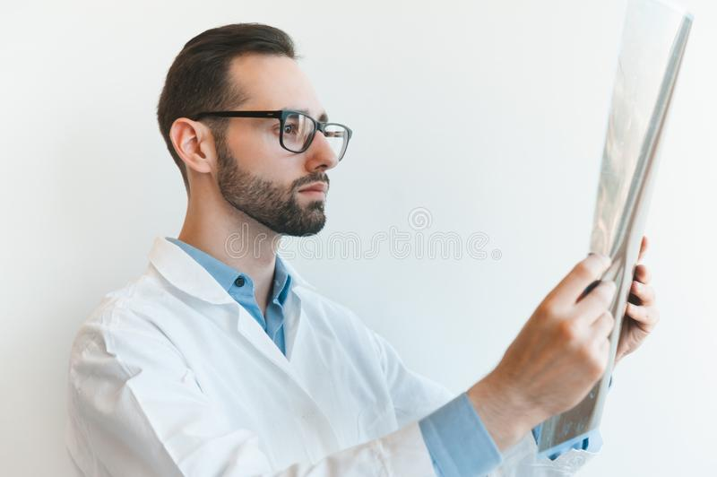 Young doctor looking at Magnetic resonance imaging shot of knee-joint. meniscus injury royalty free stock photos