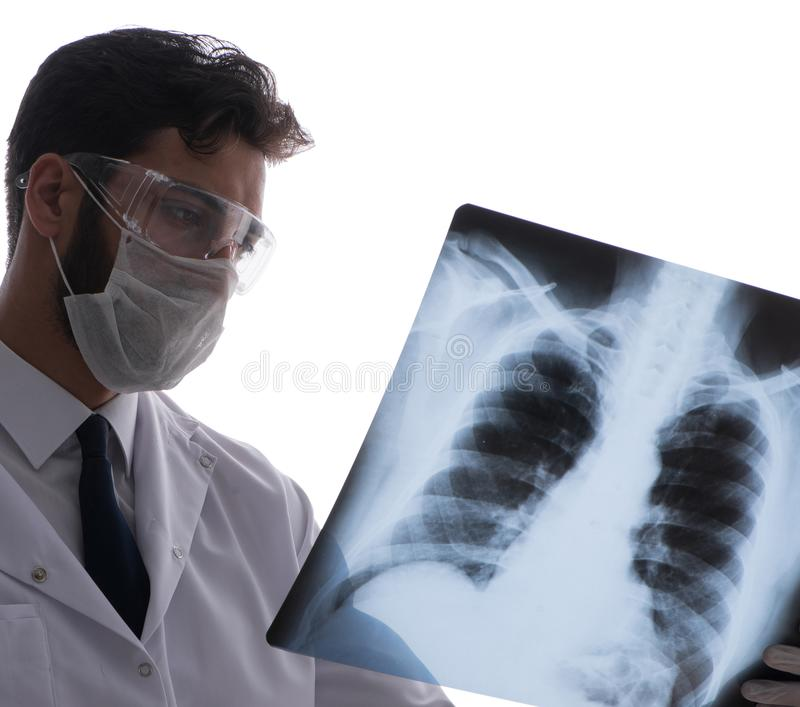 Young doctor looking at x-ray images isolated on white. The young doctor looking at x-ray images isolated on white stock photo