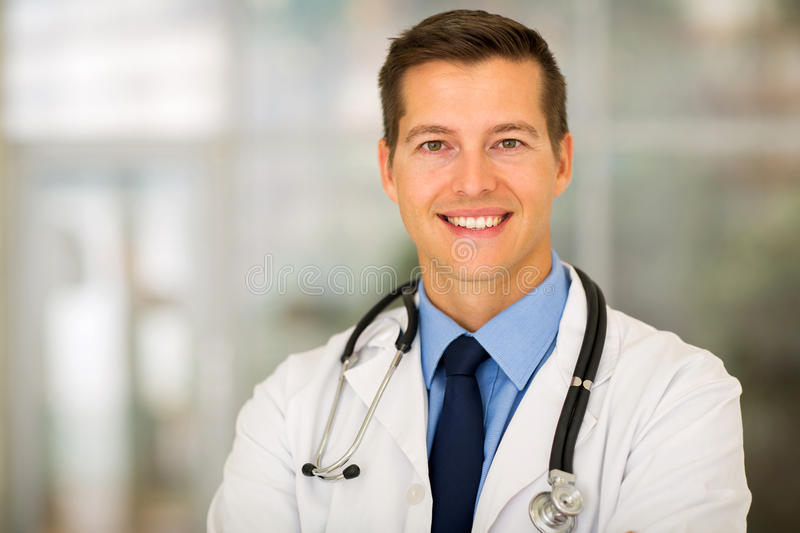 Young doctor office. Portrait of young doctor in modern office stock image